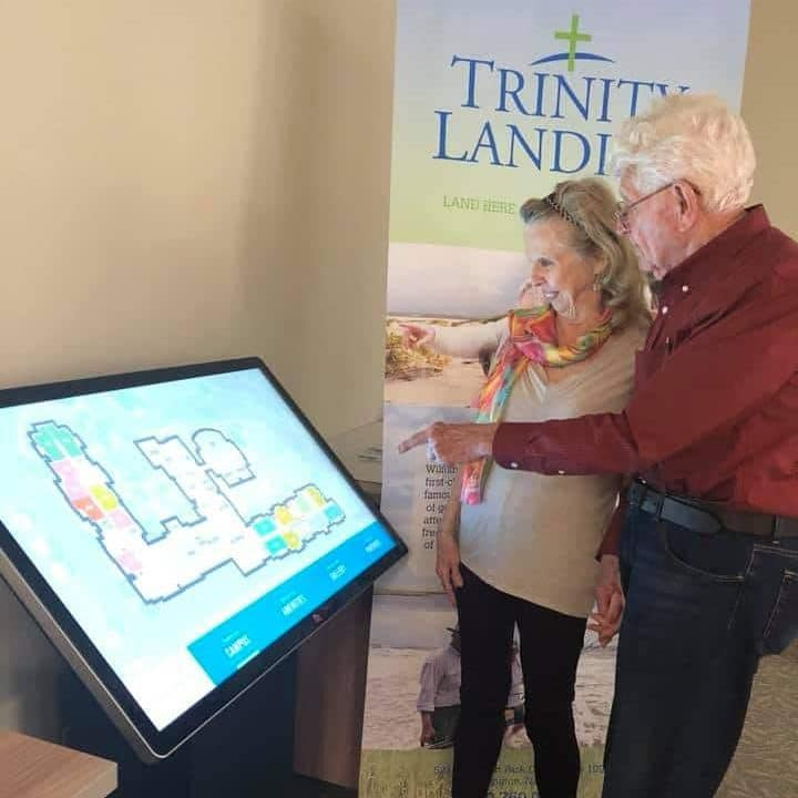 Future residents use the virtual tour board to check out the Trinity Landing residences.