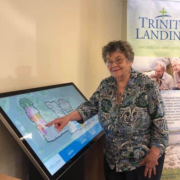 A future resident uses the virtual tour board to check out the Trinity Landing residences.